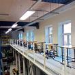 Tussenvloer voor opslag - VUB Brussel - gangpad met lessenaars